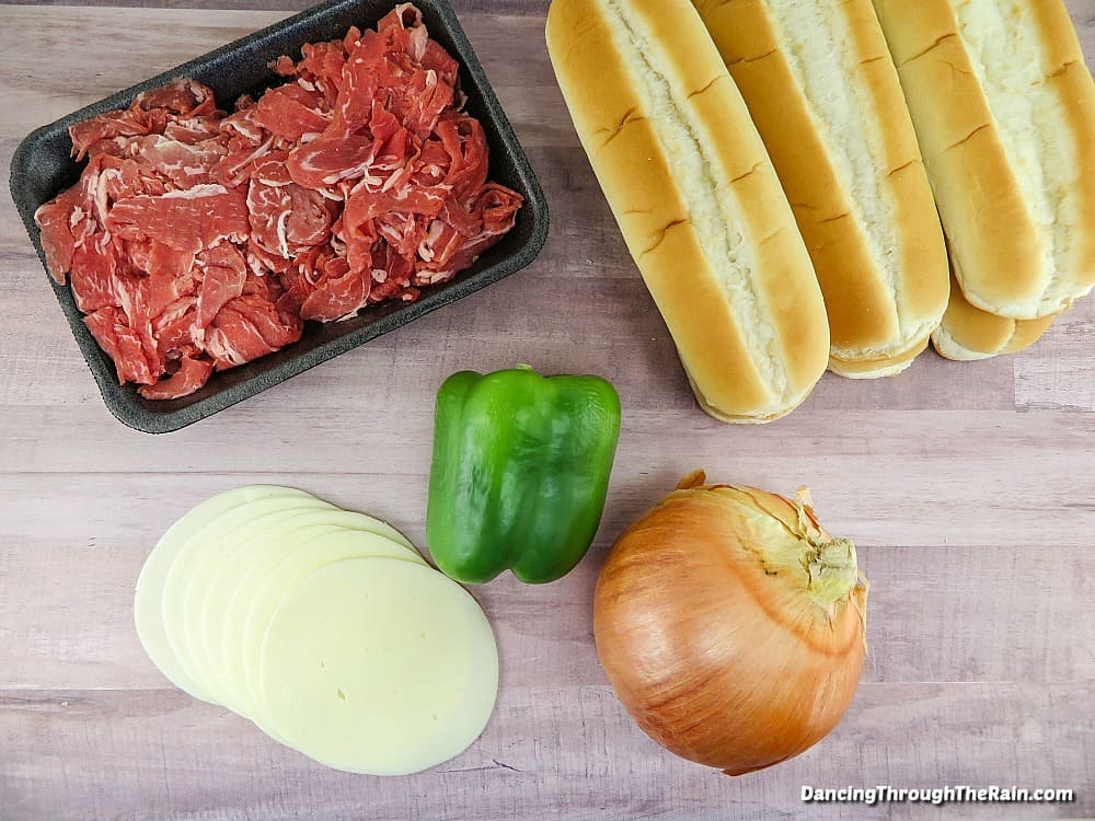 Hoagie rolls, raw beef, provolone slices, green pepper and onion