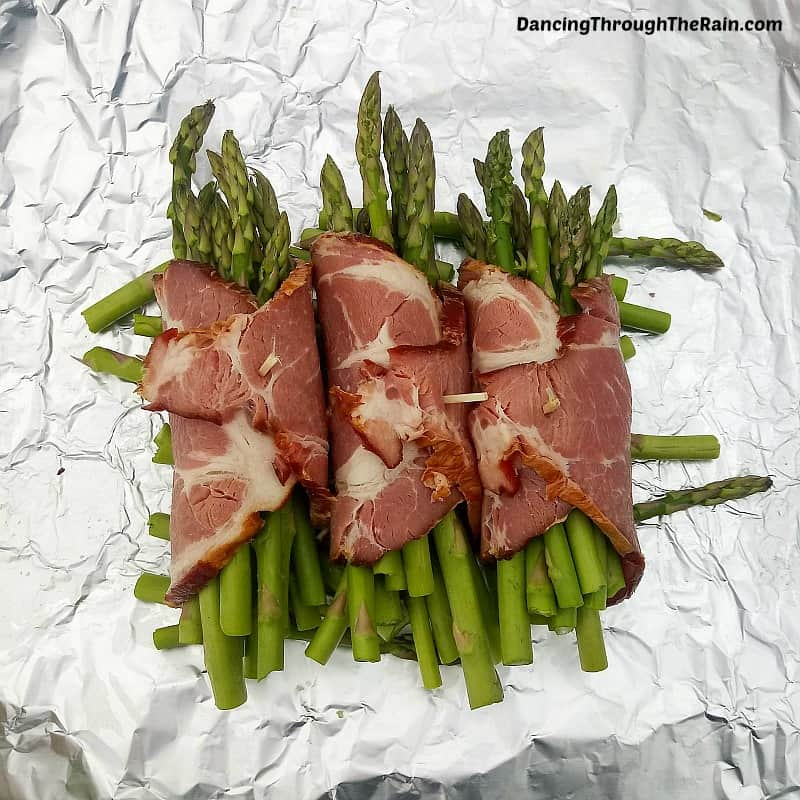 Bacon Wrapped Asparagus on aluminum foil
