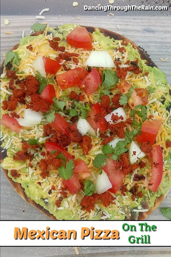 When looking for a recipe to make on the grill, I'm sure you don't think of pizza. Let this Mexican Pizza change the way you think of grilling! Add this to your list of campfire recipes for the next time you are camping or grilling in the backyard! #grilling #recipes #grillrecipes #camping #campfirerecipes #pizza #pizzarecipes