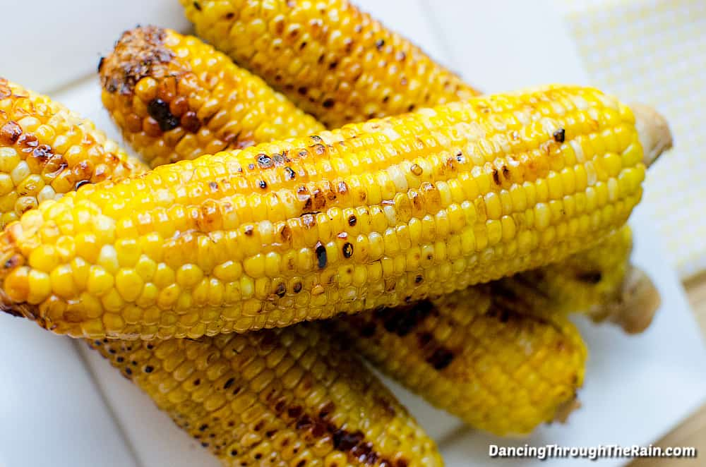 Four Sweet and Spicy Corn on the Cob on a white square plate