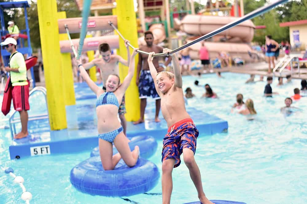 Kids walking across tubes on water at Noah's Ark Waterpark