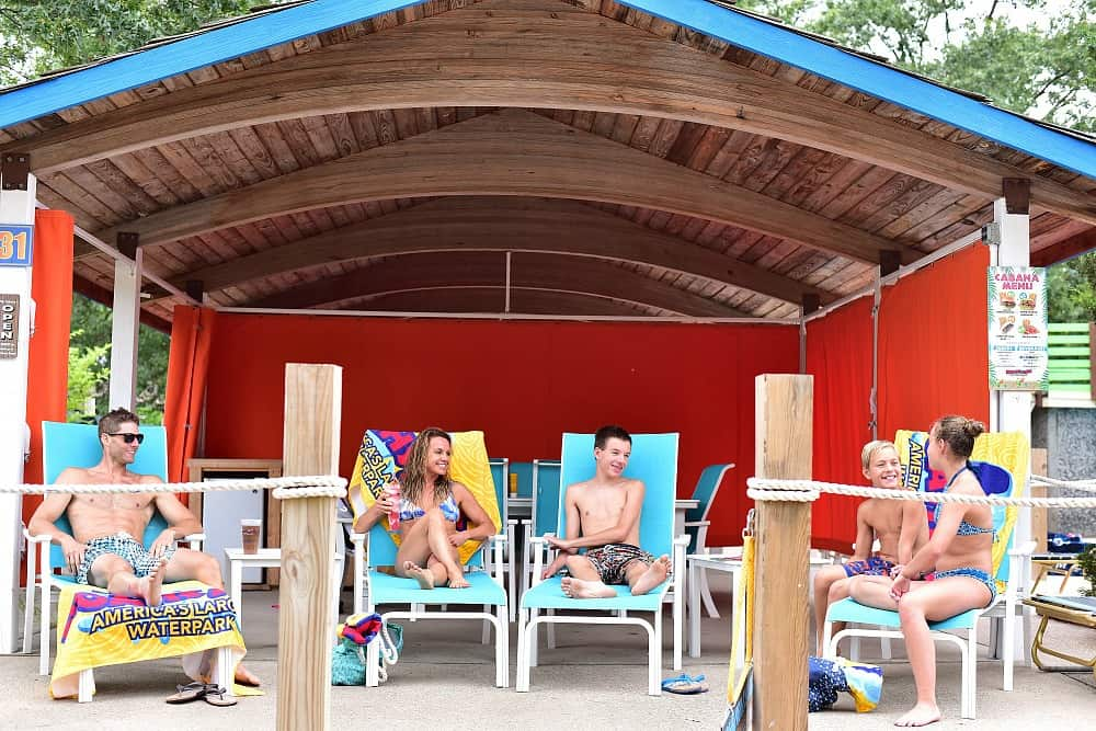 Family cabana with people sitting at Noah's Ark Waterpark