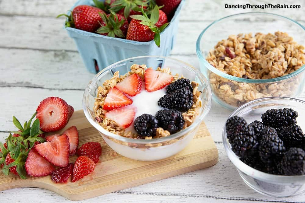 Yogurt breakfast bowl with granola, strawberries and blackberries