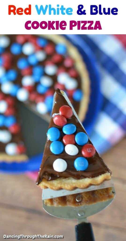 Red White & Blue Cookie Pizza with a slice cut out on a spatula