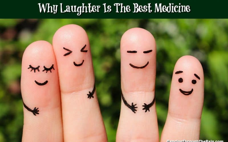 Fingers with laughing characters drawn on them