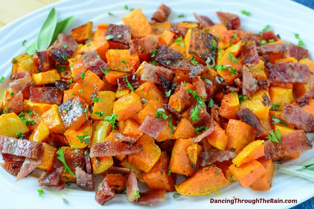 Butternut squash with bacon on a white platter