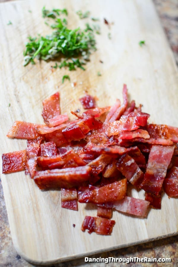 Bacon and sage chopped in piles on a cutting board