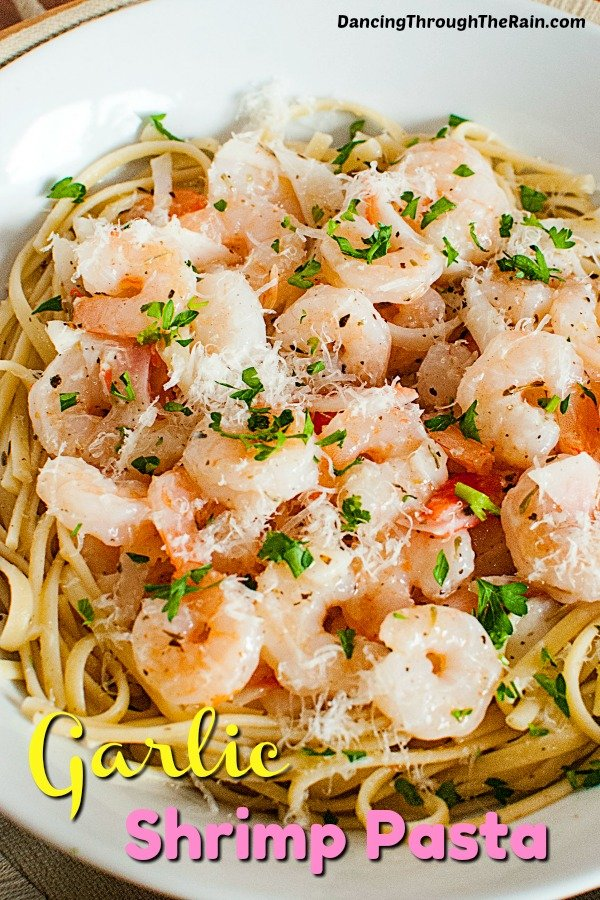 A closeup of Seafood Lemon Garlic Pasta in a white bowl