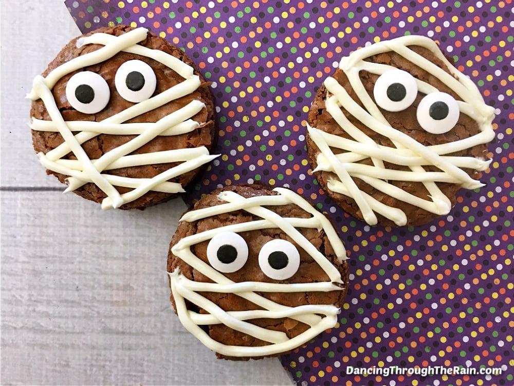 Three Halloween Mummy Brownies on a purple polka dot placemat