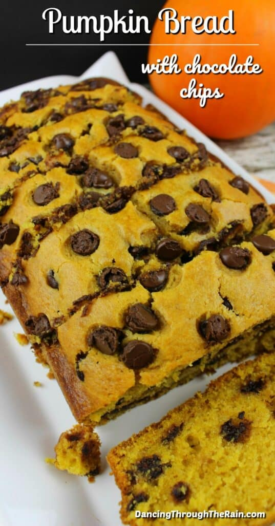 A picture of Pumpkin Chocolate Chip Bread sliced into pieces on a white plate