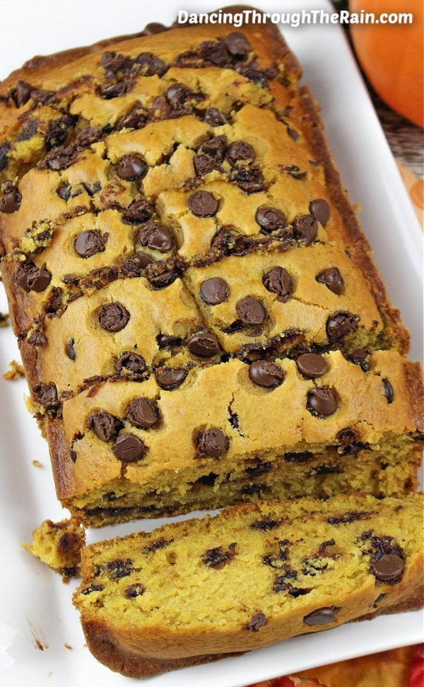 A loaf of Pumpkin Chocolate Chip Bread cut into pieces on a white tray