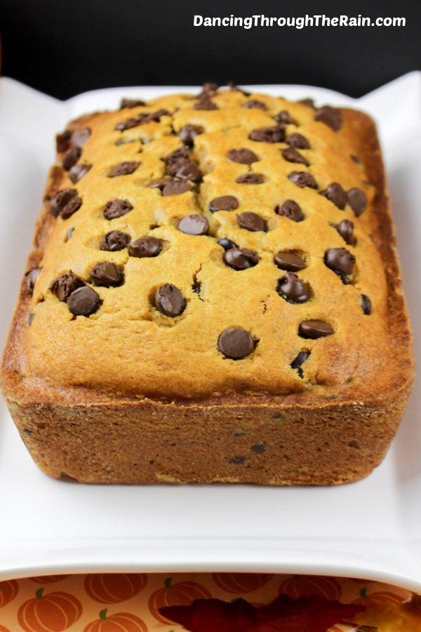 A loaf of Pumpkin Chocolate Chip Bread on a white plate
