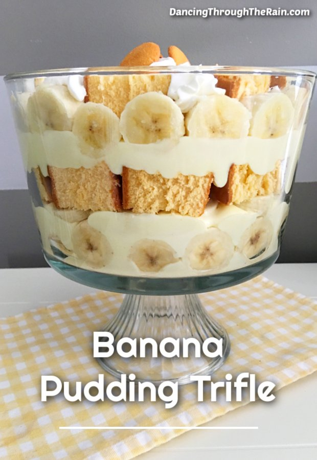 A banana pudding trifle on a yellow and white gingham napkin on a white table