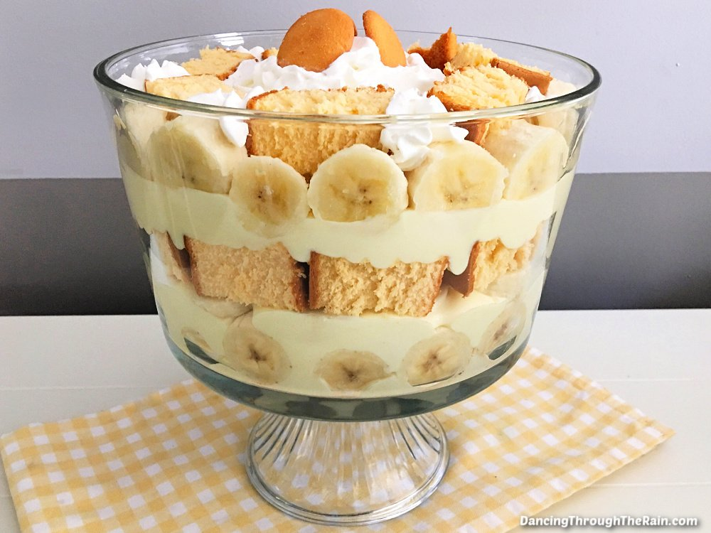 A Banana Pudding Trifle on a white table with a yellow and white checkered placemat