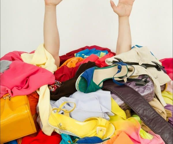 A woman drowning in her clothes and shoes