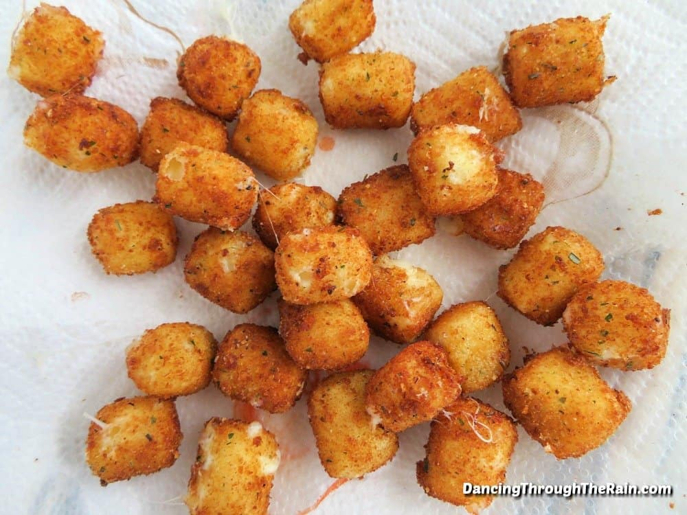 Fried cheese bites on a paper towel after being fried