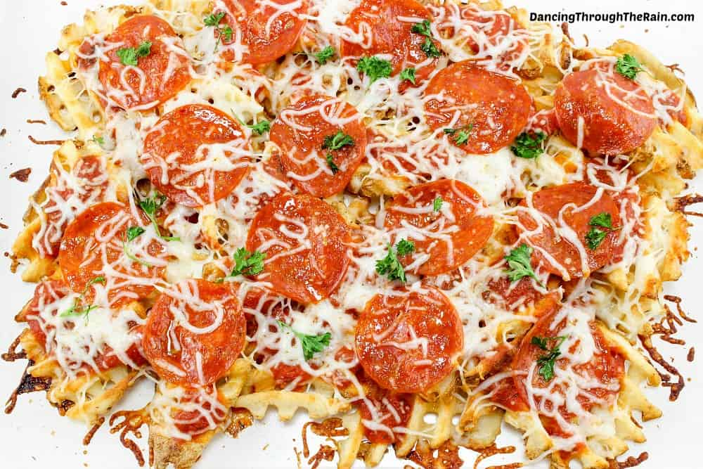 Baked pepperoni pizza fries on a white baking sheet