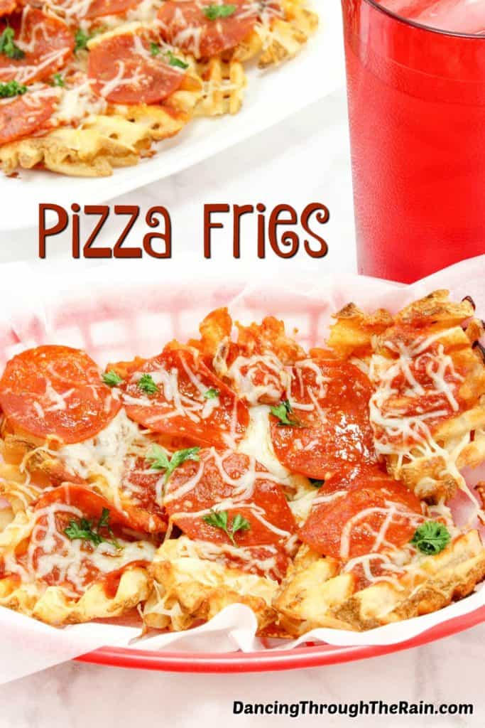 Pepperoni Pizza Waffle Fries in a red bowl next to a red cup with ice in it and a white pan with the rest of the pizza fries