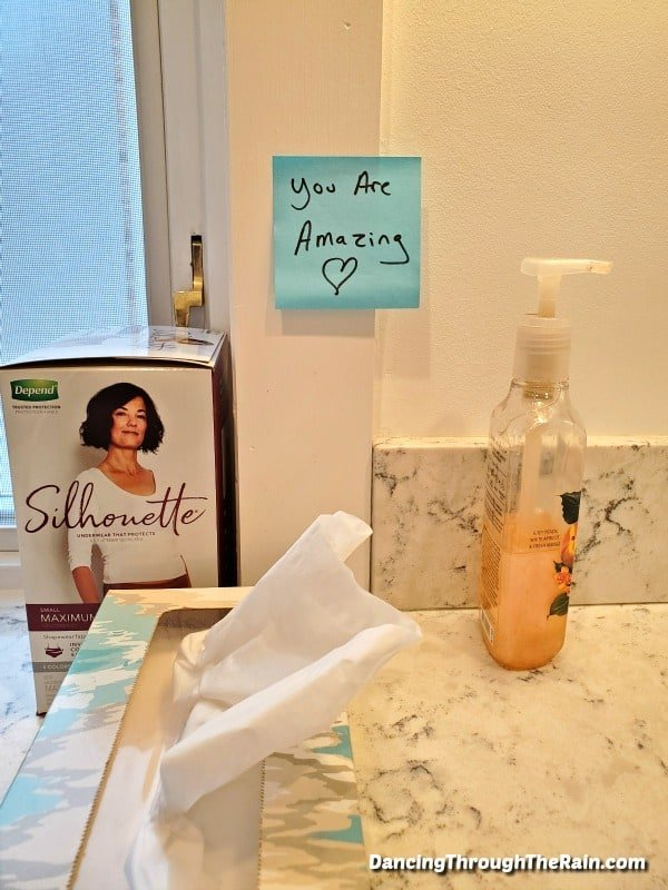"A photo of a bathroom with Depend Silhouette, tissues, a hand soap pump and a post-it that says ""you are amazing"" with a heart"