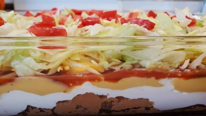 7-Layer Taco Dip image pictured from the side, looking at each of the seven layers