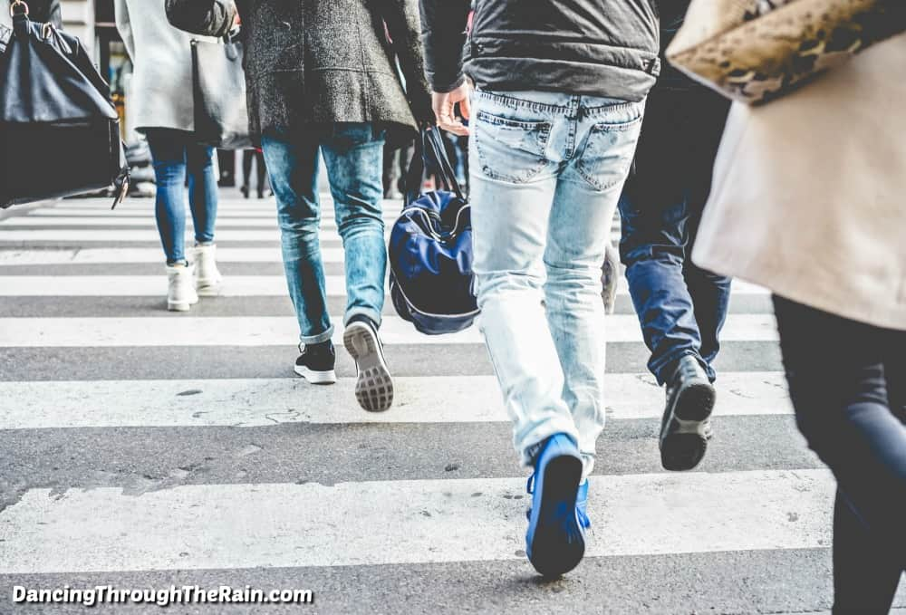 People walking across the street, where you only see their legs in jeans