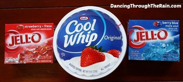 Strawberry Jello, Cool Whip and Berry Blue Jello on a table