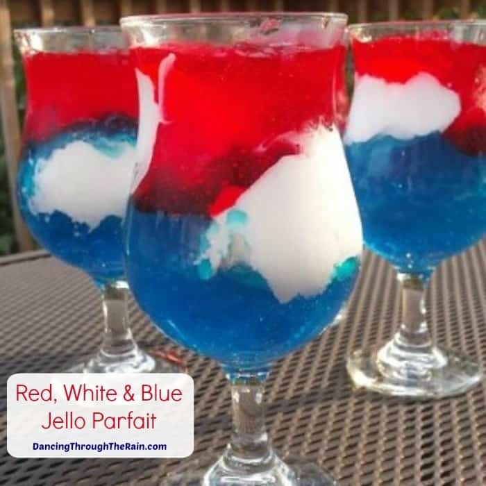 Three Red White and Blue Jello Parfaits on a metal table
