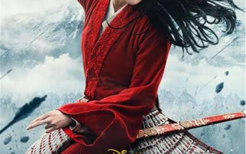 A picture of Mulan 2020 by Disney with a sword being yielded above her head