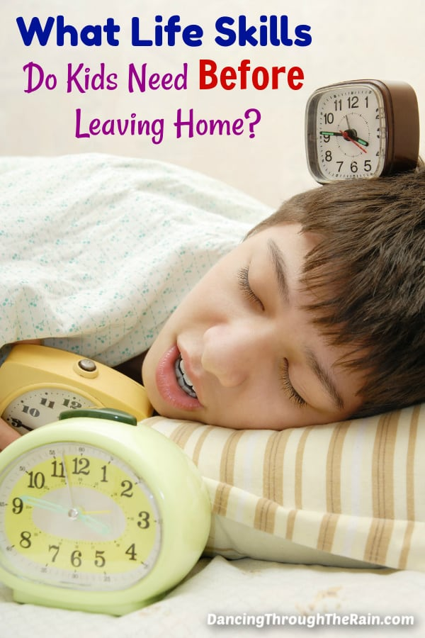 A boy laying in bed with alarm clocks around him and the words What Life Skills Do Kids Need Before Leaving Home