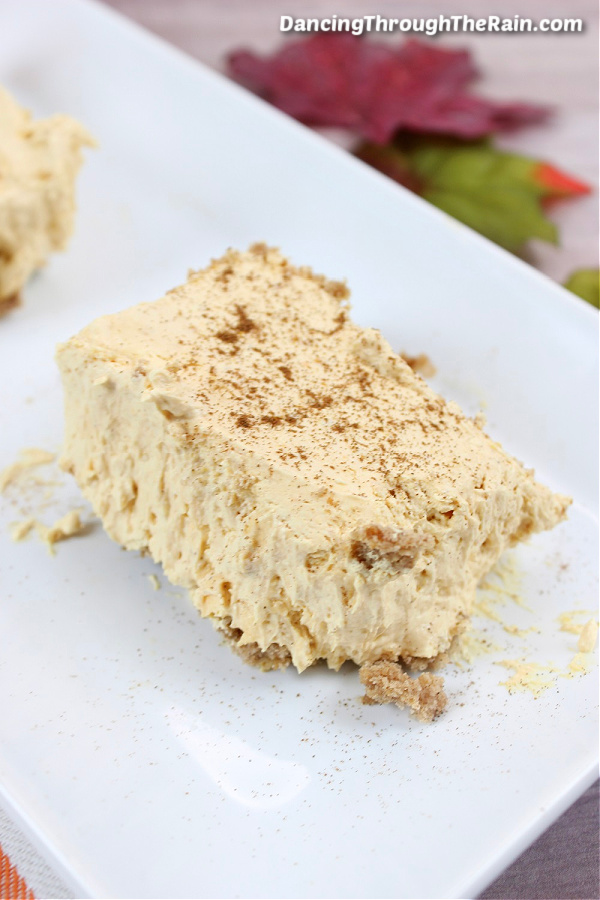 A white plate with a Pumpkin Cheesecake Bar