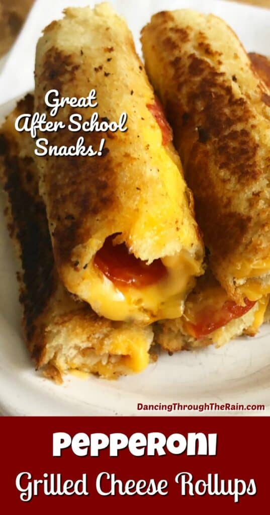 Pepperoni Grilled Cheese Rollups stacked on top of each other on a white plate