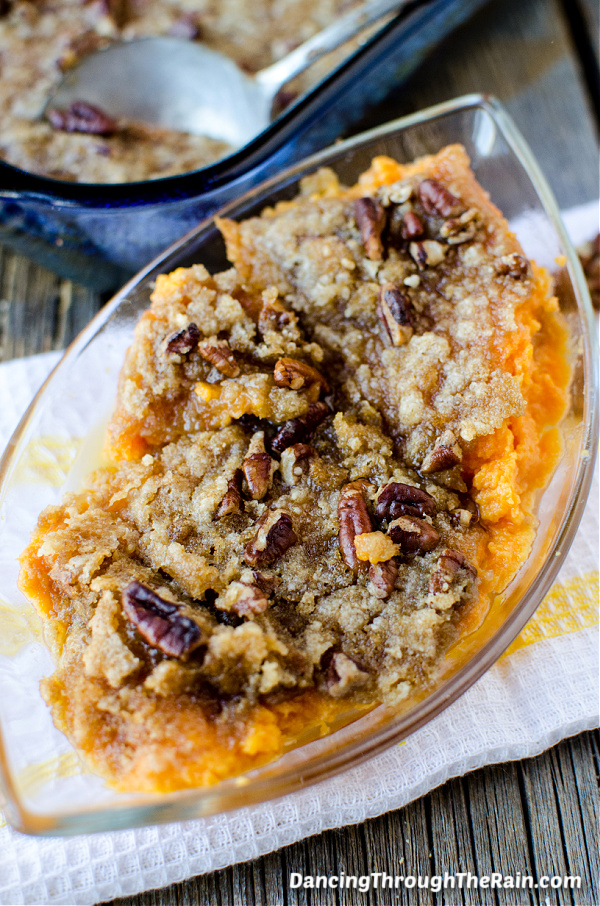 A clear serving dish with The Best Sweet Potato Casserole inside