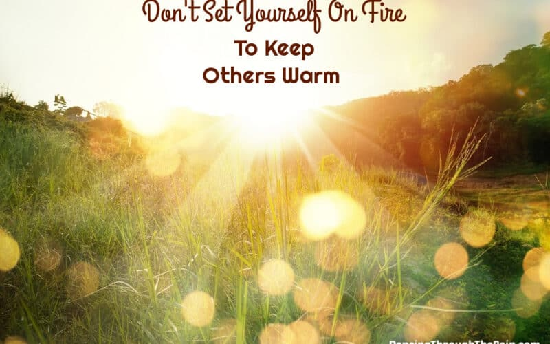A field with the sun shining on it with the words Don't Set Yourself On Fire To Keep Others Warm