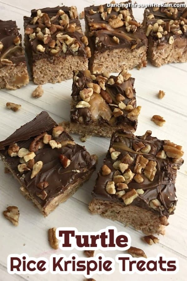 Seven Turtle Rice Krispie Squares on a white table with pecans scattered around them