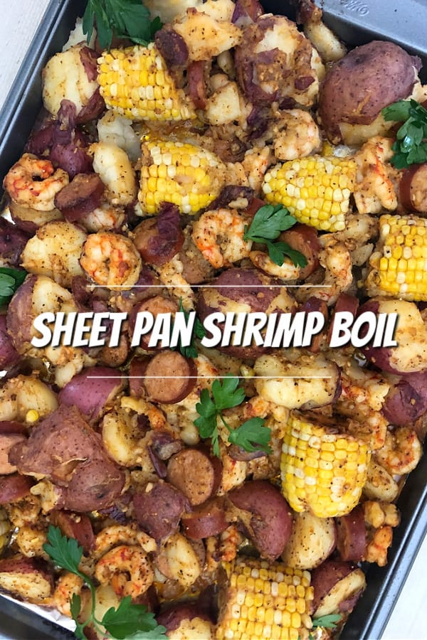 A closeup of the cooked Sheet Pan Shrimp Boil on a rimmed baking sheet