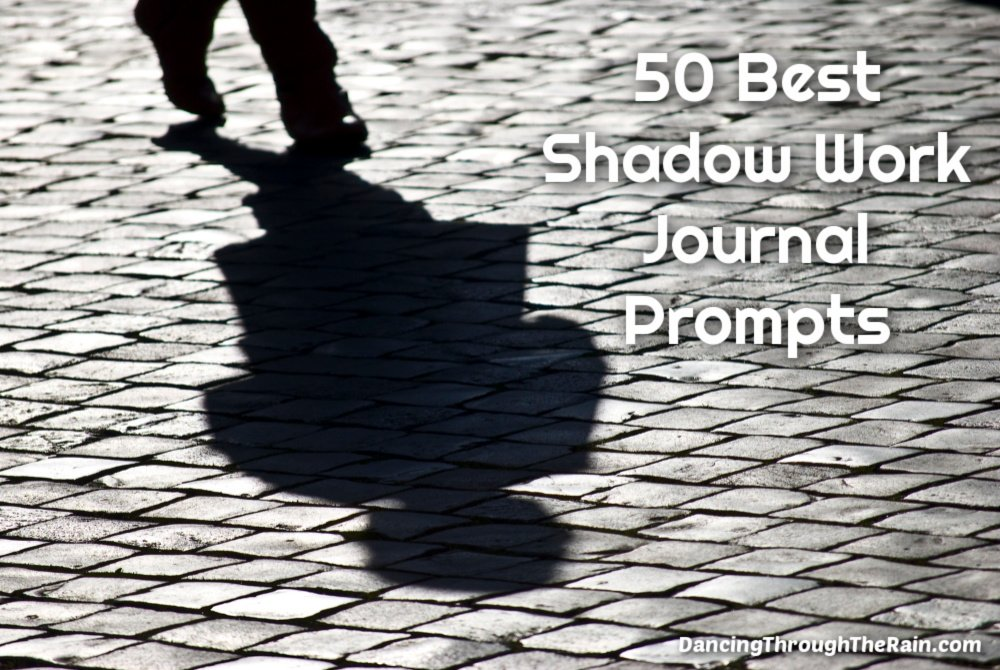 A person standing on a cobblestone street with a visible shadow of their body